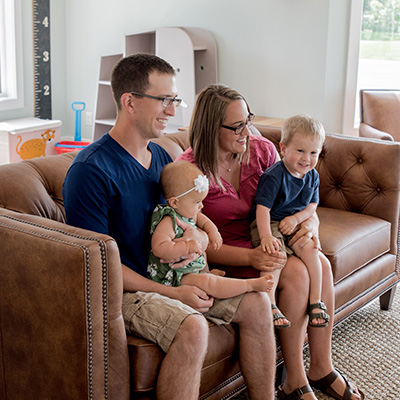 Family on couch in waiting area